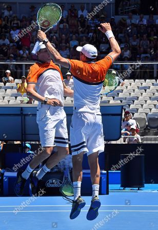 Bob Mike Bryan. United States' Bob, left, and Mike Bryan, celebrate after winning their men's doubles match against Max Mirnyi of Belarus and Austria's Phillip Oswald at the Australian Open tennis championships in Melbourne, Australia
