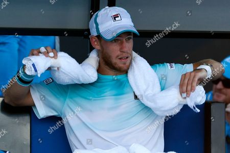 Argentina's Diego Schwartzman puts an ice towel around his neck during break in his third round game against Ukraine's Alexandr Dolgopolov at the Australian Open tennis championships in Melbourne, Australia