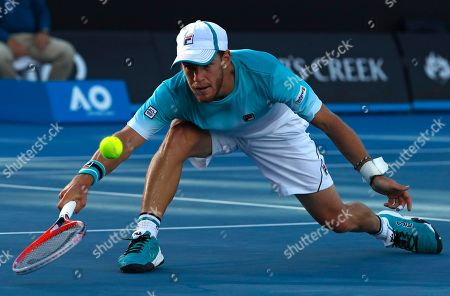 Argentina's Diego Schwartzman reaches for a backhand return to Ukraine's Alexandr Dolgopolov during their third round match at the Australian Open tennis championships in Melbourne, Australia