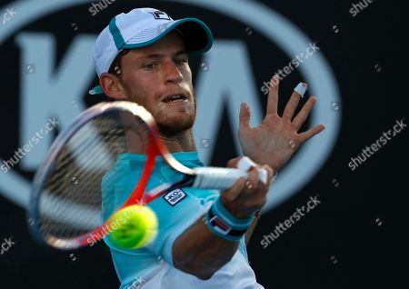 Argentina's Diego Schwartzman makes a forehand return to Ukraine's Alexandr Dolgopolov during their third round match at the Australian Open tennis championships in Melbourne, Australia