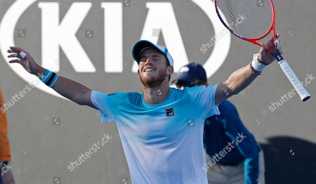 Argentina's Diego Schwartzman celebrate after defeating Ukraine's Alexandr Dolgopolov in their third round match at the Australian Open tennis championships in Melbourne, Australia