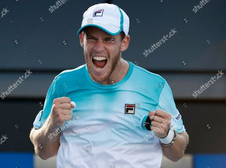 Argentina's Diego Schwartzman celebrates after defeating Ukraine's Alexandr Dolgopolov in their third round match at the Australian Open tennis championships in Melbourne, Australia