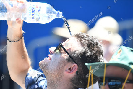 A spectator is seen cooling down during the match between Bob Bryan and Mike Bryan of the USA against Max Mirnyi of Belarus and Philipp Oswald of Austria during round two on day five of the Australian Open tennis tournament in Melbourne, Victoria, Australia, 19 January 2018.