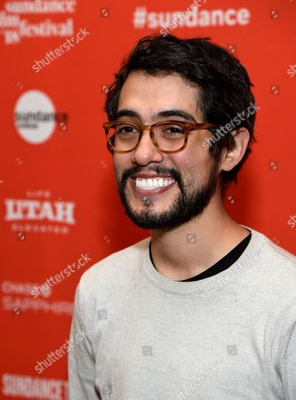 """Carlos Lopez Estrada, director of """"Blindspotting,"""" poses at the premiere of the film on the opening day of the 2018 Sundance Film Festival, in Park City, Utah"""