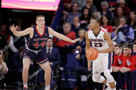 Stock Image of Zach Norvell Jr., Cullen Neal. Gonzaga guard Zach Norvell Jr. (23) dribbles the ball while defended by Saint Mary's guard Cullen Neal (44) during the second half of an NCAA college basketball game in Spokane, Wash