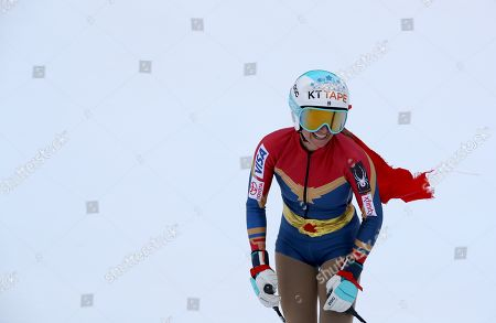 United States' Julia Mancuso wears a Wonder Woman suit and smiles as she completes an alpine ski, women's World Cup downhill, in Cortina D'Ampezzo, Italy, Friday, Jan.19, 2018. Mancuso announced she will retire from skiing after a goodbye run in a World Cup downhill Friday