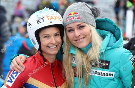 United States' Julia Mancuso, left, smiles next to United States' Lindsey Vonn at an alpine ski, women's World Cup downhill, in Cortina D'Ampezzo, Italy, Friday, Jan.19, 2018. Mancuso announced she will retire from skiing after a goodbye run in a World Cup downhill Friday