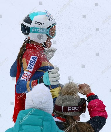United States' Julia Mancuso, top, is celebrated by members of the US ski team, after completing an alpine ski, women's World Cup downhill, in Cortina D'Ampezzo, Italy, Friday, Jan.19, 2018. Mancuso announced she will retire from skiing after a goodbye run in a World Cup downhill Friday