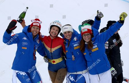 From left, Italy's Johanna Schnarf, United States' Julia Mancuso, Italy's Nadia Fanchini and Italy's Elena Fanchini celebrate Mancuso after completing an alpine ski, women's World Cup downhill, in Cortina D'Ampezzo, Italy, Friday, Jan.19, 2018. Mancuso announced she will retire from skiing after a goodbye run in a World Cup downhill Friday