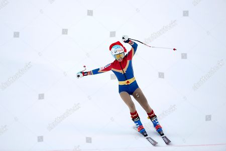 United States' Julia Mancuso, wearing a Wonder Woman suit, crosses the finish line of an alpine ski, women's World Cup downhill, in Cortina D'Ampezzo, Italy, Friday, Jan.19, 2018. Mancuso announced she will retire from skiing after a goodbye run in a World Cup downhill Friday
