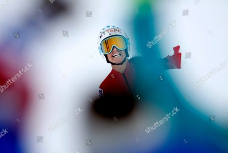 United States' Julia Mancuso, wearing a Wonder Woman suit, celebrates after completing an alpine ski, women's World Cup downhill, in Cortina D'Ampezzo, Italy, Friday, Jan.19, 2018. Mancuso announced she will retire from skiing after a goodbye run in a World Cup downhill Friday