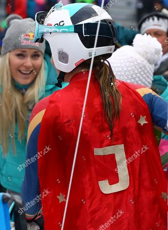 United States' Julia Mancuso, wearing a Wonder Woman suit with a J on a red cape, celebrates after completing an alpine ski, women's World Cup downhill, in Cortina D'Ampezzo, Italy, Friday, Jan.19, 2018. Mancuso announced she will retire from skiing after a goodbye run in a World Cup downhill Friday. In the background in United States' Lindsey Vonn