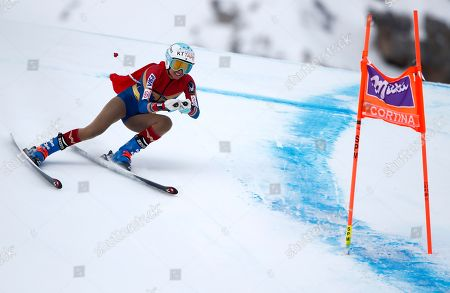 United States' Julia Mancuso, wearing a Wonder Woman suit, speeds down the course of an alpine ski, women's World Cup downhill, in Cortina D'Ampezzo, Italy, Friday, Jan.19, 2018. Mancuso announced she will retire from skiing after a goodbye run in a World Cup downhill Friday