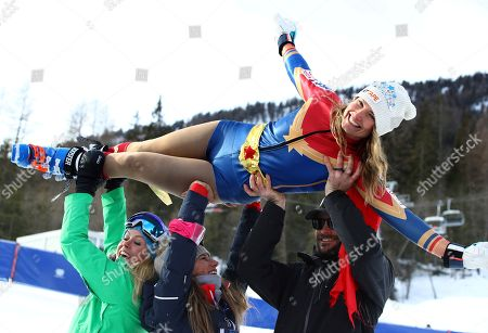 Stock Photo of United States' Julia Mancuso is celebrated by members of the US ski team at the end of an alpine ski, women's World Cup downhill, in Cortina D'Ampezzo, Italy, Friday, Jan.19, 2018. Four-time Olympic medalist Mancuso announced she will retire from skiing after a goodbye run in a World Cup downhill Friday