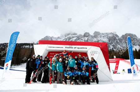 Stock Picture of United States' Julia Mancuso, center, is celebrated by the US ski team at the end of an alpine ski, women's World Cup downhill, in Cortina D'Ampezzo, Italy, Friday, Jan.19, 2018. Four-time Olympic medalist Mancuso announced she will retire from skiing after a goodbye run in a World Cup downhill Friday