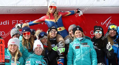 United States' Julia Mancuso is celebrated by the US ski team at the end of an alpine ski, women's World Cup downhill, in Cortina D'Ampezzo, Italy, Friday, Jan.19, 2018. Four-time Olympic medalist Mancuso announced she will retire from skiing after a goodbye run in a World Cup downhill Friday