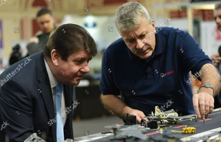 Stock Photo of Stephen Metcalfe MP (left) the new Government Envoy for the Year of Engineering. The London Model Engineering Exhibition held at Alexandra Palace in North London.