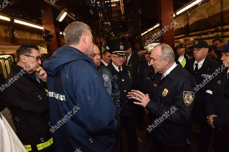 Following an active shooter drill in an abandoned subway station, from left, Fire Commissioner Daniel A. Nigro, Mayor Bill de Blasio and U.S. Secretary of Homeland Security Jeh C. Johnson listen as Police Commissioner William J. Bratton, center, addresses a news conference in New York, . Following the Nov. 13 terror attack in Paris and four days before New York's Macy's Thanksgiving Day Parade, emergency responders from the New York Police Department, Fire Deptartment of New York and Homeland Security participated in the drill. After the Pairs attacks, Bratton warned that the city could be the next target
