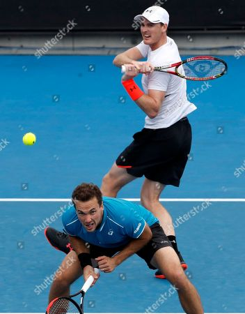 Jamie Murray, Bruno Soares. Britain's Jamie Murray, top, hits a return past partner Brazil's Bruno Soares during their doubles match against India's Leander Paes and Purav Raja at the Australian Open tennis championships in Melbourne, Australia