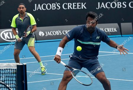 Purav Raja Leander Paes. India's Leander Paes, right, makes a backhand return as partner Purav Raja, left, watches during their doubles match against Britain's Jamie Murray and Brazil's Bruno Soares at the Australian Open tennis championships in Melbourne, Australia