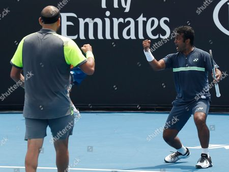 Purav Raja Leander Paes. India's Leander Paes, right, and Purav Raja celebrate a point win against Britain's Jamie Murray and Brazil's Bruno Soares during their doubles match at the Australian Open tennis championships in Melbourne, Australia