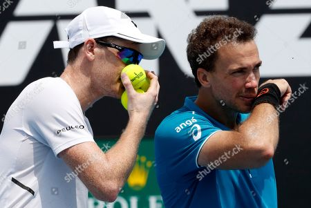 Jamie Murray, Bruno Soares. Britain's Jamie Murray, left, talks to partner Brazil's Bruno Soares during their doubles match against India's Leander Paes and Purav Raja at the Australian Open tennis championships in Melbourne, Australia