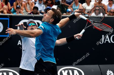 Jamie Murray, Bruno Soares. Britain's Jamie Murray, left, and partner Brazil's Bruno Soares both attempt to hit the ball during their doubles match against India's Leander Paes and Purav Raja at the Australian Open tennis championships in Melbourne, Australia
