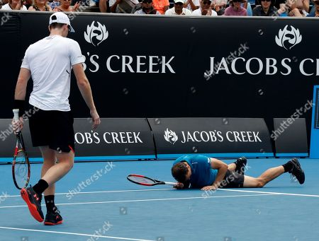 Jamie Murray, Bruno Soares. Brazil's Bruno Soares lies on the court as partner Jamie Murray watches during their doubles match against India's Leander Paes and Purav Raja at the Australian Open tennis championships in Melbourne, Australia