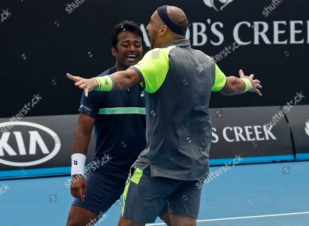 Purav Raja Leander Paes. India's Leander Paes, left, and Purav Raja celebrate after defeating Britain's Jamie Murray and Brazil's Bruno Soares in their second round doubles match at the Australian Open tennis championships in Melbourne, Australia
