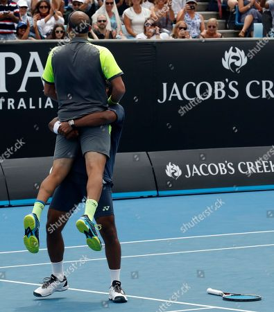 Purav Raja Leander Paes. India's Leander Paes hoists partner Purav Raja as they celebrate after defeating Britain's Jamie Murray and Brazil's Bruno Soares in their second round doubles match at the Australian Open tennis championships in Melbourne, Australia