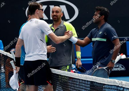Purav Raja Leander Paes. India's Leander Paes, right, and partner Purav Raja are congratulated by Britain's Jamie Murray, left, and Brazil's Bruno Soares, obscured, after winning their second round doubles match at the Australian Open tennis championships in Melbourne, Australia