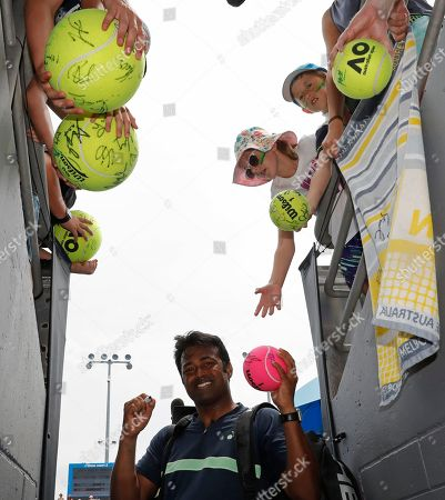 Purav Raja Leander Paes. India's Leander Paes, signs autographs after he and partner Purav Raja defeated Britain's Jamie Murray and Brazil's Bruno Soares in their second round doubles match at the Australian Open tennis championships in Melbourne, Australia