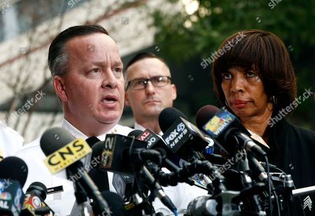 Stock Photo of Kevin Davis, Catherine Pugh. Baltimore Police Department Commissioner Kevin Davis, left, speaks alongside Mayor Catherine Pugh at a news conference outside the R Adams Cowley Shock Trauma Center in Baltimore. Pugh has replaced the city's police commissioner, saying a change in leadership is needed to reduce crime. A news release from the mayor's office, says Deputy Commissioner Darryl DeSousa will take Kevin Davis' place. The release says DeSousa, a 30-year veteran of the force, will assume responsibility immediately