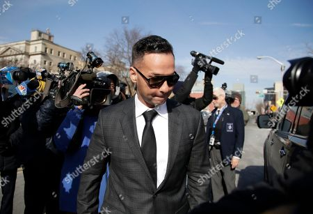 """Michael """"The Situation"""" Sorrentino, one of the former stars of the """"Jersey Shore"""" reality TV show, is swarmed by reporters while leaving the Martin Luther King, Jr., Federal Courthouse after a hearing, in Newark, N.J. Sorrentino pleaded guilty to one count of tax evasion and admitted concealing his income in 2011 by making cash deposits in amounts that wouldn't trigger federal reporting requirements. He and his brother, Marc, were charged in 2014 and again last year with multiple counts related to nearly $9 million in income from the show"""
