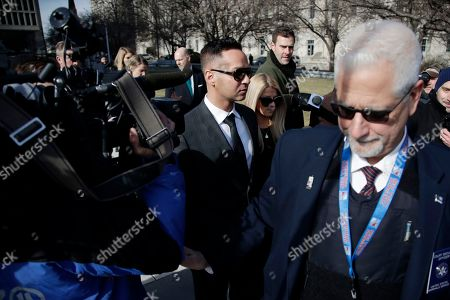 """Stock Photo of A U.S. Marshall, right, clears the path as Michael """"The Situation"""" Sorrentino, center, one of the former stars of the """"Jersey Shore"""" reality TV show, is swarmed by reporters while leaving the Martin Luther King, Jr., Federal Courthouse after a hearing, in Newark, N.J. Sorrentino pleaded guilty to one count of tax evasion and admitted concealing his income in 2011 by making cash deposits in amounts that wouldn't trigger federal reporting requirements. He and his brother, Marc, were charged in 2014 and again last year with multiple counts related to nearly $9 million in income from the show"""