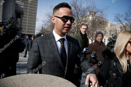 """Michael """"The Situation"""" Sorrentino, one of the former stars of the """"Jersey Shore"""" reality TV show, leaves the Martin Luther King, Jr., Federal Courthouse after a hearing, in Newark, N.J. Sorrentino pleaded guilty to one count of tax evasion and admitted concealing his income in 2011 by making cash deposits in amounts that wouldn't trigger federal reporting requirements. He and his brother, Marc, were charged in 2014 and again last year with multiple counts related to nearly $9 million in income from the show"""