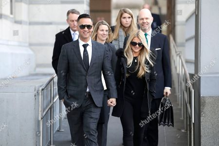 """Stock Image of Michael """"The Situation"""" Sorrentino, left, one of the former stars of the """"Jersey Shore"""" reality TV show, walks with his fiancee Lauren Pesce while leaving the Martin Luther King, Jr., Federal Courthouse after a hearing, in Newark, N.J. Sorrentino pleaded guilty to one count of tax evasion and admitted concealing his income in 2011 by making cash deposits in amounts that wouldn't trigger federal reporting requirements. He and his brother, Marc, were charged in 2014 and again last year with multiple counts related to nearly $9 million in income from the show"""