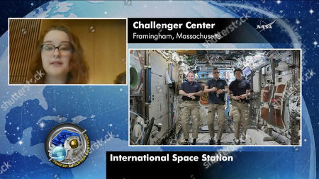 In this image made from video provided by NASA, astronauts Scott Tingle, Joe Acaba, Norishige Kanai, aboard the International Space Station, take questions from students at Framingham State University in Framingham, Mass., on . Thirty-two years after the Challenger disaster, teachers turned astronauts Acaba and Ricky Arnold will pay tribute to Christa McAuliffe by carrying out her science classes on the International Space Station