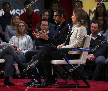 Sundar Pichai, Susan Wojcicki. Google CEO Sundar Pichai gestures beside YouTube CEO Susan Wojcicki during the taping of a television program, in San Francisco
