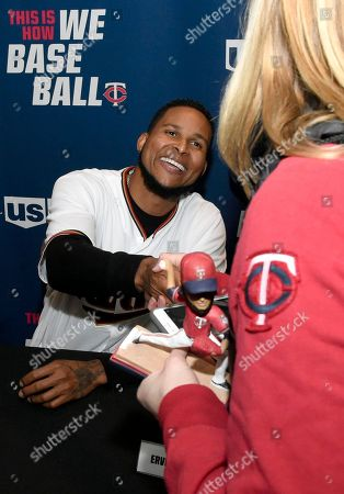 Minnesota Twins' Ervin Santana greets a person attending the baseball team's TwinsFest, in Minneapolis