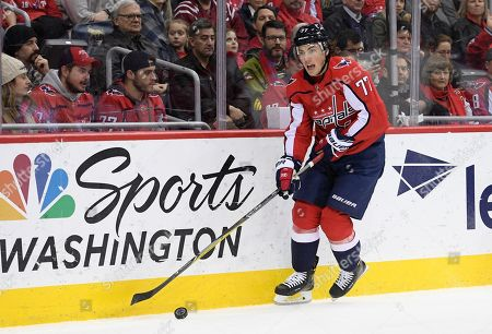 587dca2eefa Washington Capitals right wing T.J. Oshie (77) skates with the puck during  the first