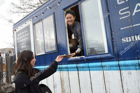 Stock Picture of Top Chef winner Kristen Kish serves up one-of-a-kind treats at the Chase Sapphire On Location Food Truck at the Sundance Film Festival, in Park City, Utah