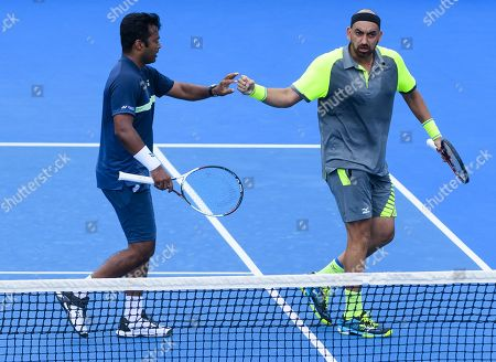 Leander Paes of India and Purav Raja of India in action on Day 6 of the Australian Open