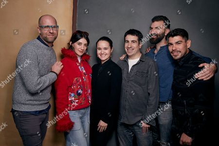"Dan Kitrosser, Sheila Vand, Christina D. King, Jeremy Yaches, Jeremiah Zagar, Raul Castillo. Writer Dan Kitrosser, Sheila Vand, producer Christina D. King, producer Jeremy Yaches, writer/director Jeremiah Zagar and Raul Castillo, from left, pose for a portrait to promote the film ""We the Animals,"" at the Music Lodge during the Sundance Film Festival, in Park City, Utah"