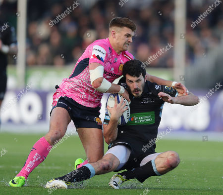 Leonardo Sarto of Glasgow Warriors is tackled by Henry Slade of Exeter Chiefs during the European Rugby Champions Cup match between Glasgow Warriors and Exeter Chiefs at Scotstoun Stadium on January 20th 2018, Exeter, Devon (