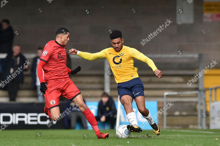 Louis Dennis of Bromley competes for the ball with Jamie Reid of Torquay United, during the Vanarama National League match between Torquay United and Bromley at Plainmoor, Torquay, Devon on January 20