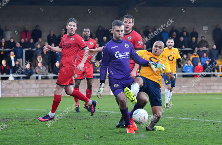 David Gregory of Bromley battles for the ball with Elliott Romain of Torquay United, during the Vanarama National League match between Torquay United and Bromley at Plainmoor, Torquay, Devon on January 20