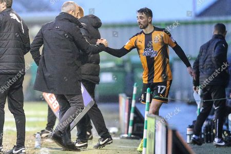 Cambridge United's Adam Phillpis(17) is subbed and shakes hands with Cambridge United's manager Shaun Derry during the EFL Sky Bet League 2 match between Forest Green Rovers and Cambridge United at the New Lawn, Forest Green