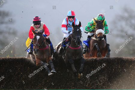 Master Of Verse ridden by Richard Dunne (L) jumps alongside Enola Gay ridden by Harry Bannister (R). - RACE 2 - 1:40 Taunton - 20 Jan 2018 - Bathwick Tyres Taunton Chase (A Novices' Limited Handicap) (Class 4) at Taunton Racecourse, Taunton, Somerset, England