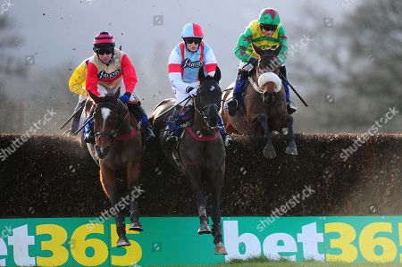 Master Of Verse ridden by Richard Dunne (L) jumps alongside Enola Gay ridden by Harry Bannister (C). - RACE 2 - 1:40 Taunton - 20 Jan 2018 - Bathwick Tyres Taunton Chase (A Novices' Limited Handicap) (Class 4) at Taunton Racecourse, Taunton, Somerset, England